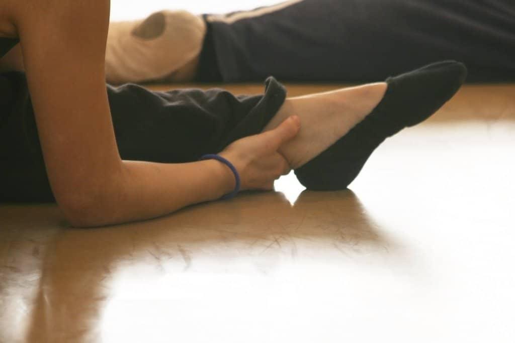 foot of dancer in ballet shoes