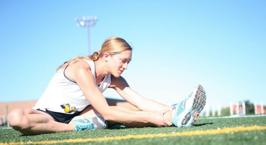 female runner stretching