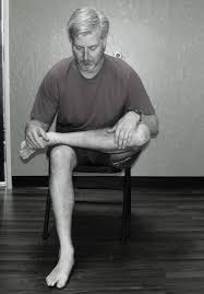 man sitting with legs crossed